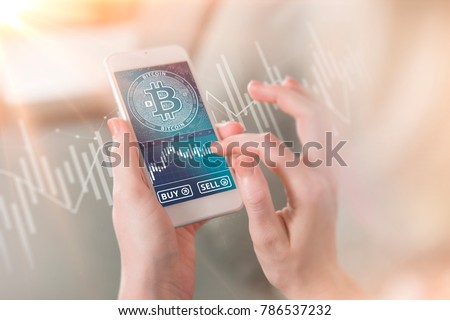 Bitcoin symbol on mobile app screen with big BUY and SELL buttons. Bitcoin on stock market. New digital money. #786537232