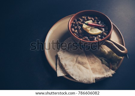 Ful Medames - is an Egyptian dish of cooked Fava beans served with vegetable oil, lemon, chili. It is a popular traditional/oriental food in Egypt and all middle east. #786606082