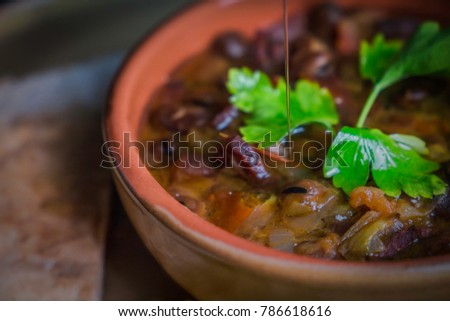 Ful Medames - is an Egyptian dish of cooked Fava beans served with vegetable oil, lemon, parsley. It is a popular traditional/oriental food in Egypt and all middle east. #786618616