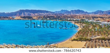 Sharm El Maya is one of the central districts of resort, that boasts scenic rocky landscape and beautiful beaches with palms and multiple sunshades, Sharm El Sheikh, Egypt. #786620743