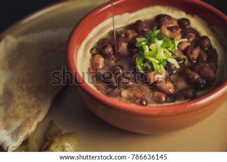 A close up color studio image of Egyptian, Arabian, Middle Eastern Traditional food (Fava Beans with Tahini) A.K.A (Foul) - Also served in Lebanon and most of Arabian countries. #786636145