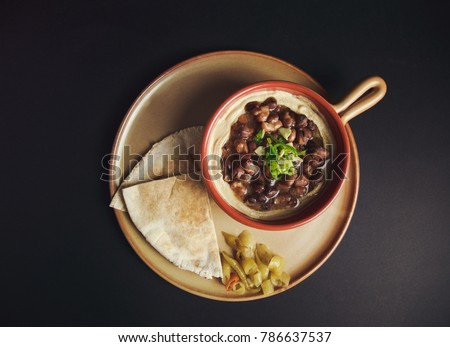 Studio color image (high angle view)  of Egyptian, Arabian, Middle Eastern Traditional food (Fava Beans with Tahini) A.K.A (Foul) - Also served in Lebanon and most of Arabian countries. #786637537