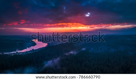 Panoramic aerial view of flying over the forests in the evening