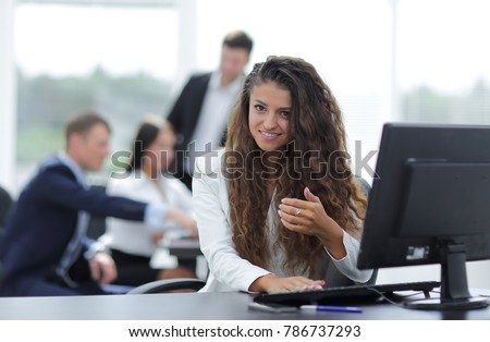 Manager woman sitting behind a Desk #786737293
