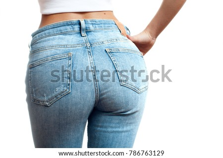 Woman wearing of jean pants from back. Female bottom in tight jeans #786763129