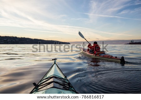 Adventure Man on a Sea Kayak is kayaking during a vibrant and colorful winter sunset. Taken in Vancouver, British Columbia, Canada. Adventure, Vacation Concept #786816817