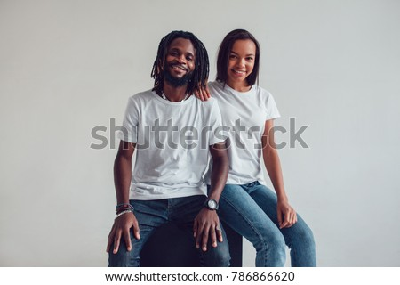Beautiful African American couple in white t-shirts. Mock-up. #786866620