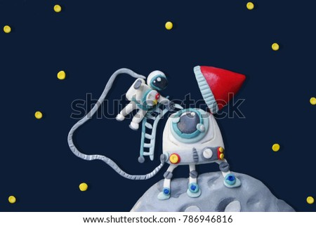 Plasticine rocket and astronaut in space with moon and star for education and science concept