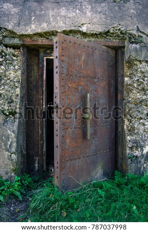 Heavy metal, rusty door to the military facility #787037998