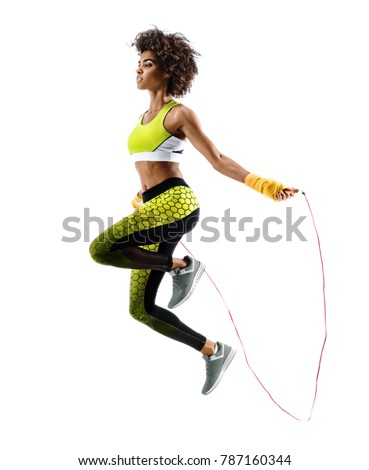 Young girl with skipping rope on white background. Best cardio workout #787160344