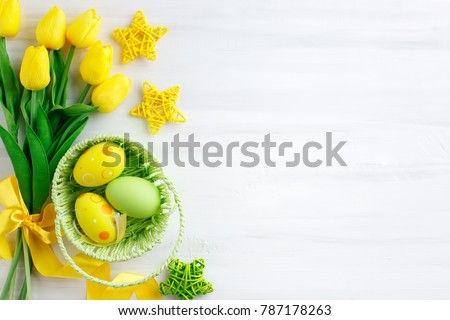 Happy Easter. Congratulatory easter background. Easter eggs and flowers. #787178263