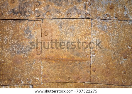 Rusty metal sheets with rivets as background #787322275