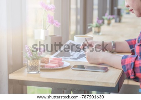Close Up of woman hands using mobile phone and laptop computer with blank copy space screen for your advertising text message or content business at a coffee shop with a document. #787501630