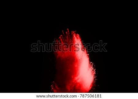 Red powder explosion on black background. #787506181