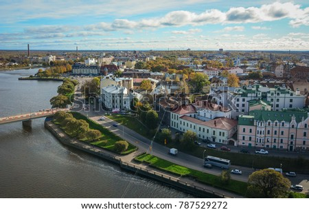 Vyborg, Russia - Oct 6, 2016. View of Vyborg Township with the river. Vyborg stands at the head of Vyborg Bay of the Gulf of Finland, 113 km northwest of St. Petersburg. #787529272