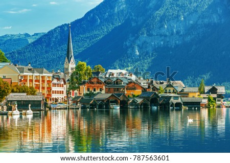 Scenic picture-postcard view of famous Hallstatt mountain village in the Austrian Alps at beautiful evening light at sunset in summer, Salzkammergut region, Hallstatt, Austria