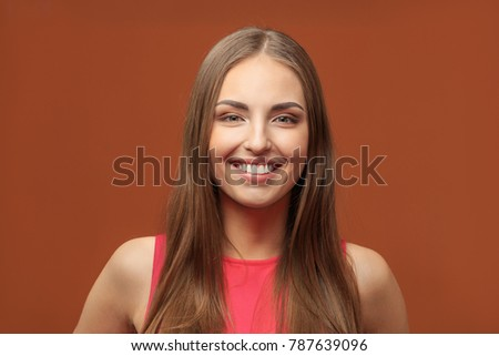 Young laughing woman in a red dress #787639096