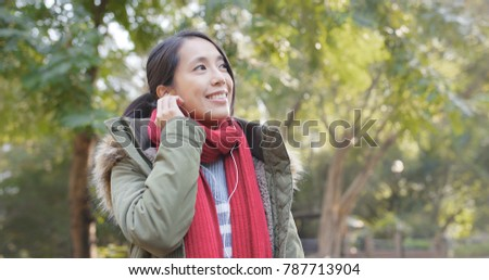 Woman listen to music on mobile phone in china  #787713904