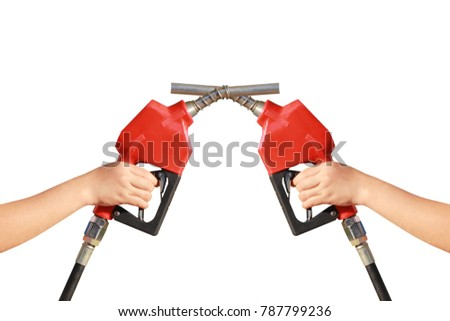 Woman hand holding two a fuel nozzle red on white background #787799236