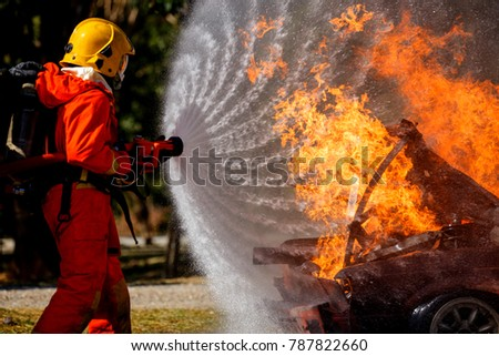 Firefighters are fighting fire with a  fire brigade #787822660