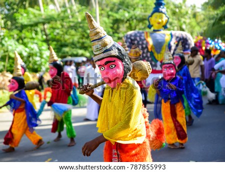 Tangalle, Sri Lanka, August 12 2017: masquerade on the street during traditional Perahera procession, one of the most colorful Buddhist festivals taking place during full moon. #787855993