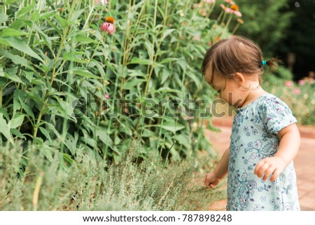 Little Girl Picking Flowers Side View #787898248