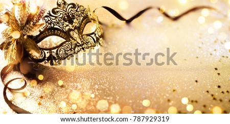 Venetian Golden Mask On Shiny Defocused Background #787929319