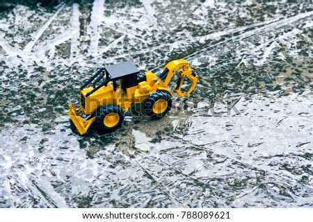 Bulldozer working in the middle of the icy road. #788089621