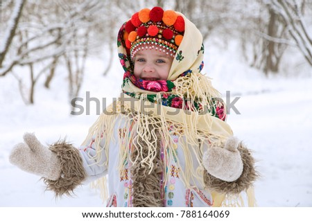 little girl in winter forest. dressed in the Ukrainian national clothes. joyful time #788164069
