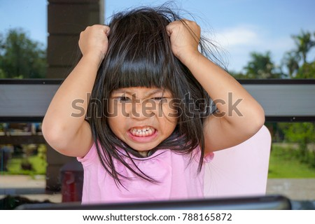 Angry Asian cute girl screaming after her mother take a tablet away. Stressed child, Kid  with attention deficit hyperactivity disorder (ADHD) can't handle her emotion.   Royalty-Free Stock Photo #788165872