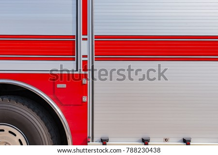 side of a fire truck as background
