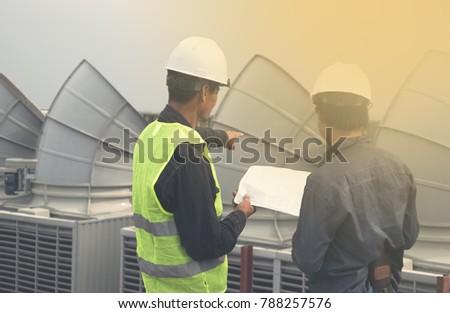 Consultant for installing the cooling tower is inspecting the installation contractor.Construction, engineer,site,management,safety,civil,workers #788257576