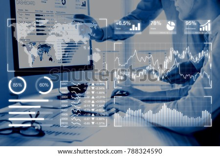 Business analytics dashboard reporting concept with key performance indicators (KPI) and two people analyzing sales or digital marketing data on computer screen in background Royalty-Free Stock Photo #788324590