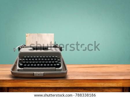Vintage typewriter with old paper. retro machine technology  #788338186
