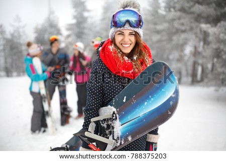 Female snowboarder hold snowboard and going to snowboarding #788375203
