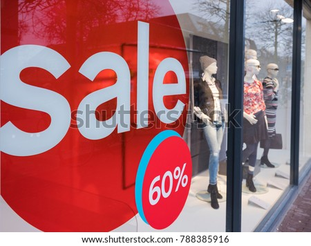 the word sale oin colorful display in shopping window during winter sale time