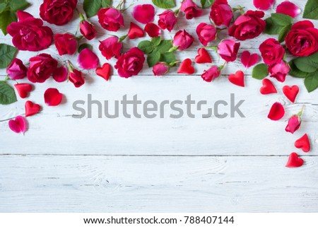 Roses and red hearts on a wooden background #788407144