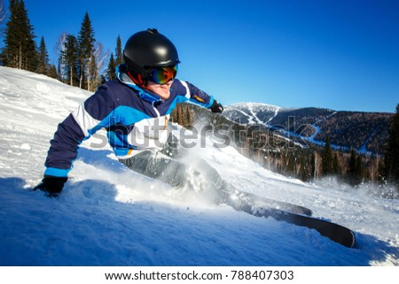 Action camera skier skiing downhill in high mountains during sunny day. #788407303