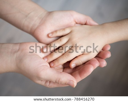mother holding baby hand #788416270