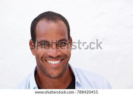 Close up portrait of handsome man laughing standing isolated on white #788420455