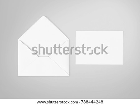 White envelope and post card on the white background, top view. Royalty-Free Stock Photo #788444248