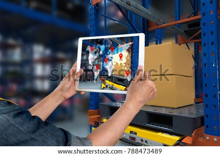 Industrial 4.0 , Augmented reality and smart logistic concept. Hand holding tablet with AR application for check order pick time around the world and supply chain in smart factory background. #788473489