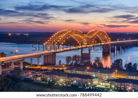 Memphis, Tennessee, USA at Hernando de Soto Bridge at dusk.