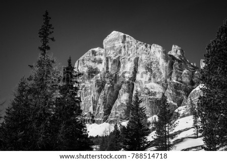 Black and white picture of Tofana di Rozes over a blue sky in winter, Cortina D'Ampezzo, Italy