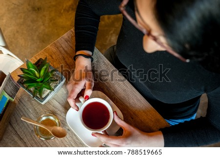 The girl drinks coffee in the cafe #788519665