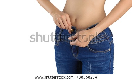 The girl in unbuttoned jeans in the sexy isolated on white background with clipping path. #788568274