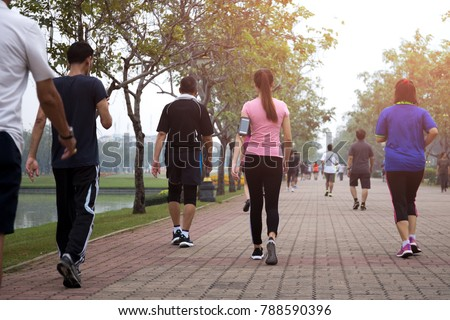 Group of people exercise walking in the park in morning #788590396