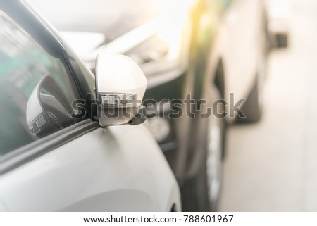 luxury car closed wing mirror after parking for safety drive