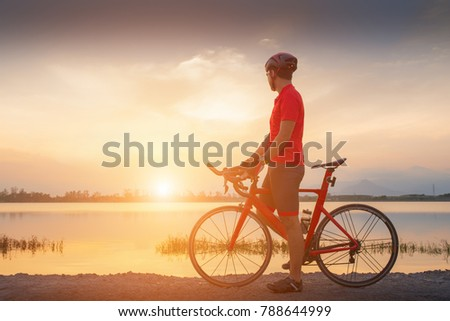 Asian men relaxing after riding bikes in the morning  #788644999