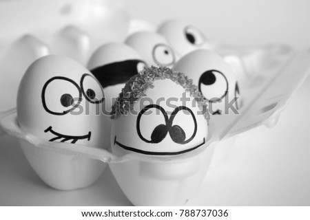 conception of hair. treatment of the bald patch. the eggs are funny and cute. photo with painted face on the shell. satire and comic. The egg is a scrap on the head. curly hair on the head. head of ha